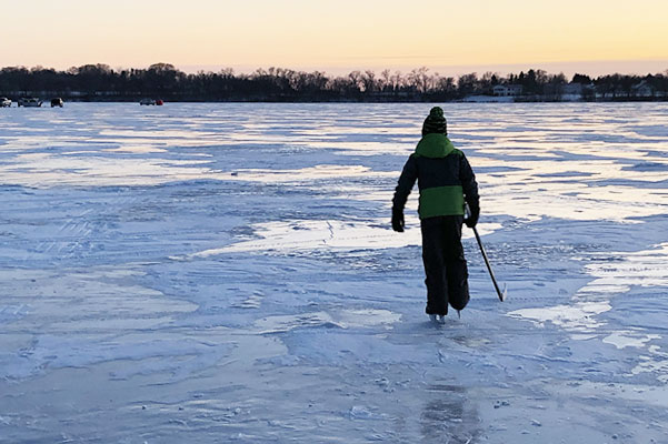 Ice fishing and skating in winter